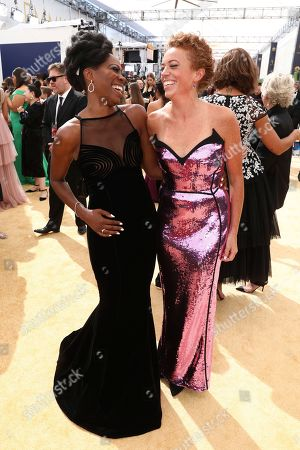 Yvonne Orji, Michelle Wolf. Yvonne Orji, left and Michelle Wolf arrive at the 70th Primetime Emmy Awards, at the Microsoft Theater in Los Angeles