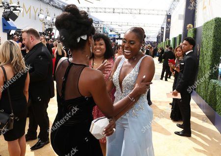 Yvonne Orji, Michelle Wolf. Yvonne Orji, left and Issa Rae arrive at the 70th Primetime Emmy Awards, at the Microsoft Theater in Los Angeles