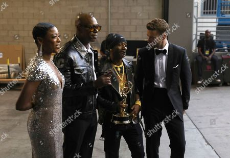 """Samira Wiley, Dave Chappelle, Katt Williams, Justin Timberlake. Samira Wiley, from left, Dave Chappelle, Katt Williams, winner of the award for outstanding guest actor in a comedy series for """"Atlanta"""", and Justin Timberlake at the 70th Primetime Emmy Awards, at the Microsoft Theater in Los Angeles"""