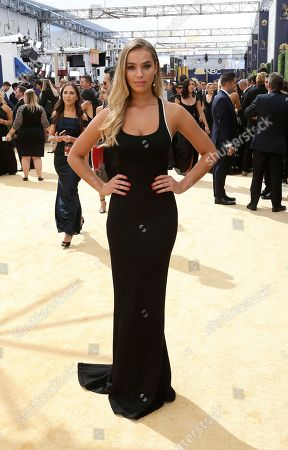 Liv Pollock arrives at the 70th Primetime Emmy Awards, at the Microsoft Theater in Los Angeles