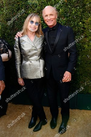Amy Madigan, Ed Harris. Amy Madigan and Ed Harris arrive at the 70th Primetime Emmy Awards, at the Microsoft Theater in Los Angeles