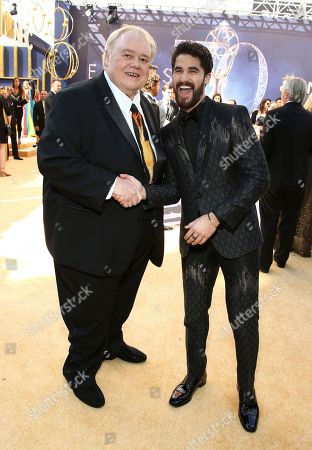 Louie Anderson, Darren Criss. Louie Anderson, left, and Darren Criss arrive at the 70th Primetime Emmy Awards, at the Microsoft Theater in Los Angeles
