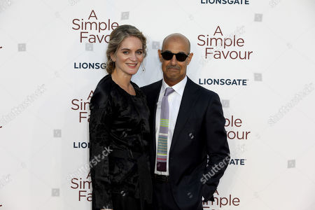 Stanley Tucci, Felicity Blunt. Actor Stanley Tucci and partner Felicity Blunt pose for photographers on arrival at the premiere of the film 'A Simple Favour