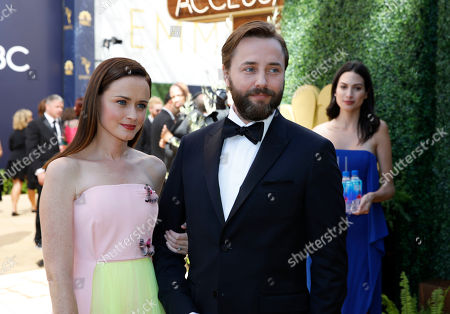 Stock Image of FIJI Water at the 70th Primetime Emmy Awards. Alexis Bledel, left, Vincent Kartheiser arrive at the 70th Primetime Emmy Awards, at the Microsoft Theater in Los Angeles