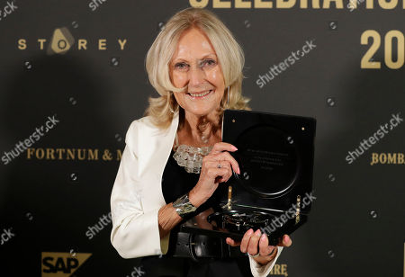 Stock Picture of Eva Jiricna holds up the award after receiving the London Design Festival 2018 Lifetime Achievement Medal at a ceremony in London, . Jiricna is a Czech-born architect based in London since 1968. A Royal Academician, CBE and royal designer for industry, she began her career at the Greater London Council, before moving on to the Louis de Soissons partnership and Richard Rogers partnership, where she was responsible for the interior design of the Lloyds of London building