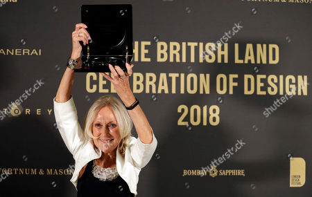 Stock Image of Eva Jiricna holds up the award after receiving the London Design Festival 2018 Lifetime Achievement Medal at a ceremony in London, . Jiricna is a Czech-born architect based in London since 1968. A Royal Academician, CBE and royal designer for industry, she began her career at the Greater London Council, before moving on to the Louis de Soissons partnership and Richard Rogers partnership, where she was responsible for the interior design of the Lloyds of London building