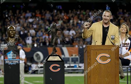 Former Chicago Bears and Hall of Fame linebacker Brian Urlacher speaks during a Ring of Excellence ceremony by the Bears during the halftime of an NFL football game against the Seattle Seahawks, in Chicago