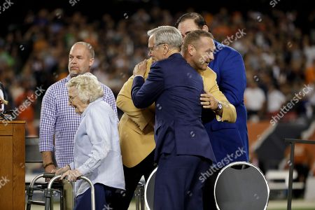 Former Chicago Bears and Hall of Fame linebacker Brian Urlacher hugs Chicago Bears chairman George McCaskey during a Ring of Excellence ceremony by the Bears during the halftime of an NFL football game against the Seattle Seahawks, in Chicago