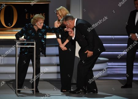 Betty White, Kate McKinnon, Alec Baldwin. Betty White, far left, is honored on stage by Kate McKinnon and Alec Baldwin at the 70th Primetime Emmy Awards, at the Microsoft Theater in Los Angeles