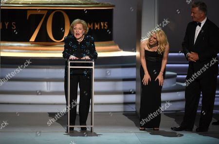 Betty White, Kate McKinnon, Alec Baldwin. Betty White, far left, speaks on stage while Kate McKinnon and Alec Baldwin look on at the 70th Primetime Emmy Awards, at the Microsoft Theater in Los Angeles