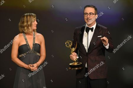 "Liz Stanton, John Oliver. Liz Stanton, left, and John Oliver accept the award for outstanding variety talk series for ""Last Week Tonight with John Oliver"" at the 70th Primetime Emmy Awards, at the Microsoft Theater in Los Angeles"