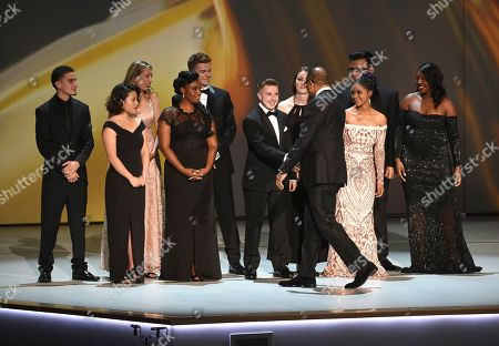 Hayma Washington, front center, chairman and CEO of the Television Academy, congratulates Television Academy interns on stage at the 70th Primetime Emmy Awards, at the Microsoft Theater in Los Angeles