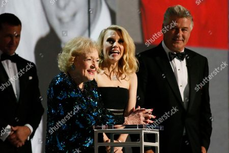 Betty White, Kate McKinnon, Alec Baldwin. Betty White, Kate McKinnon and Alec Baldwin at the 70th Primetime Emmy Awards, at the Microsoft Theater in Los Angeles