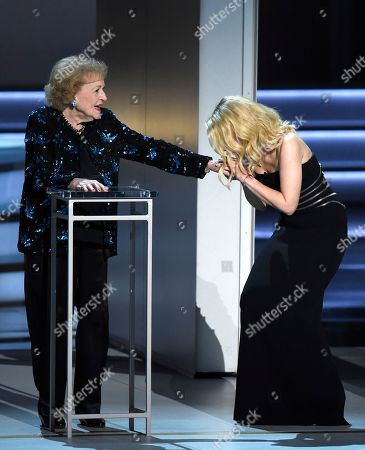 Kate McKinnon, Betty White. Kate McKinnon, right, acknowledges Betty White at the 70th Primetime Emmy Awards, at the Microsoft Theater in Los Angeles