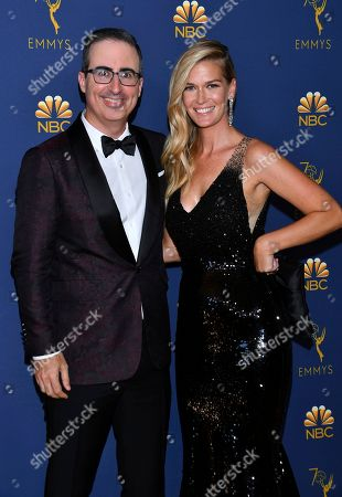 John Oliver and Kate Norley arrive at the 70th Primetime Emmy Awards, at the Microsoft Theater in Los Angeles