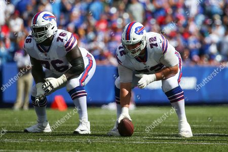Buffalo Bills offensive guard John Miller (76) and center Ryan Groy (72) line up for an offensive play against the Los Angeles Chargers during the first half of an NFL game, in Orchard Park, N.Y