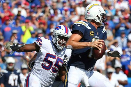 Buffalo Bills defensive end Jerry Hughes (55) pressures Los Angeles Chargers quarterback Philip Rivers (17) during the second half of an NFL game, in Orchard Park, N.Y