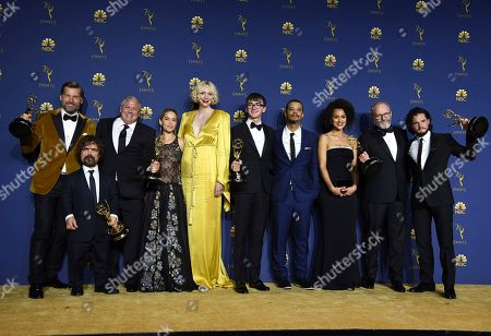 """Nikolaj Coster-Waldau, Peter Dinklage, Conleth Hill, Emilia Clarke, Gwendoline Christie, Isaac Hempstead Wright, Jacob Anderson, Nathalie Emmanue, Liam Cunningham, Kit Harington. The cast of """"Game of Thrones"""" poses backstage after winning the award for outstanding drama series at the 70th Primetime Emmy Awards, at the Microsoft Theater in Los Angeles. From left are, Nikolaj Coster-Waldau, Peter Dinklage, Conleth Hill, Emilia Clarke, Gwendoline Christie, Isaac Hempstead Wright, Jacob Anderson, Nathalie Emmanue, Liam Cunningham and Kit Harington"""