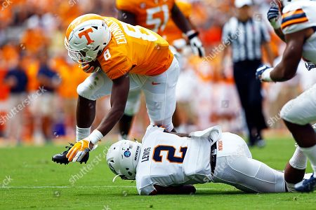 Tennessee running back Ty Chandler (8) is hit by UTEP defensive back Michael Lewis (2) in the first half of an NCAA college football game against UTEP, in Knoxville, Tenn