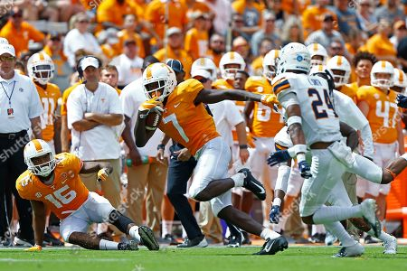 Tennessee wide receiver Brandon Johnson (7) runs for yardage as he's chased by UTEP defensive back Kahani Smith (24) in the second half of an NCAA college football game, in Knoxville, Tenn. against Tennessee won 24-0