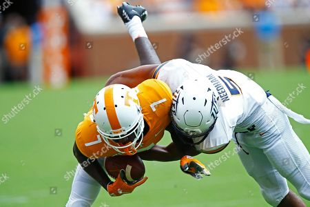 Tennessee wide receiver Brandon Johnson (7) is tackled by UTEP defensive back Nik Needham (5) in the second half of an NCAA college football game, in Knoxville, Tenn. against Tennessee won 24-0