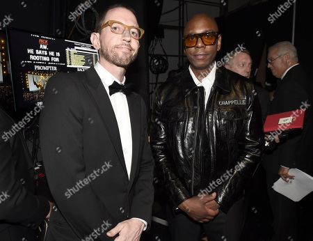 Neal Brennan, Dave Chappelle. Neal Brennan, left, and Dave Chappelle pose backstage at the 70th Primetime Emmy Awards, at the Microsoft Theater in Los Angeles