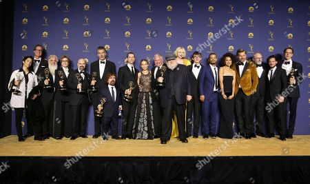 """George R.R. Martin, Nikolaj Coster-Waldau, David Benioff, D.B. Weiss, Emilia Clarke, Peter Dinklage, Gwendoline Christie, Isaac Hempstead Wright, Jacob Anderson, Nathalie Emmanuel, Kit Harington, Liam Cunningham, Conleth Hill. George R.R. Martin and the cast and crew of """"Game of Thrones"""" pose in the press room with the award for outstanding drama series for """"Game of Thrones"""" at the 70th Primetime Emmy Awards, at the Microsoft Theater in Los Angeles"""