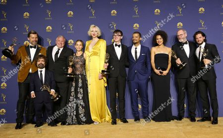 """Nikolaj Coster-Waldau, Peter Dinklage, Conleth Hill, Emilia Clarke, Gwendoline Christie, Isaac Hempstead Wright, Jacob Anderson, Nathalie Emmanuel, Liam Cunningham, Kit Harington. Nikolaj Coster-Waldau, from left, Peter Dinklage, Conleth Hill, Emilia Clarke, Gwendoline Christie, Isaac Hempstead Wright, Jacob Anderson, Nathalie Emmanuel, Liam Cunningham, and Kit Harington pose in the press room with the award for outstanding drama series for """"Game of Thrones"""" at the 70th Primetime Emmy Awards, at the Microsoft Theater in Los Angeles"""