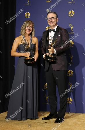 "Liz Stanton, John Oliver. Liz Stanton, left, and John Oliver pose in the press room with the award for outstanding variety talk series for ""Last Week Tonight with John Oliver"" at the 70th Primetime Emmy Awards, at the Microsoft Theater in Los Angeles"