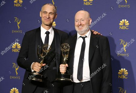 """Joel Fields, Joe Weisberg. Joel Fields, left, and Joe Weisberg pose in the press room with the award for outstanding writing for a drama series for """"The Americans"""" at the 70th Primetime Emmy Awards, at the Microsoft Theater in Los Angeles"""