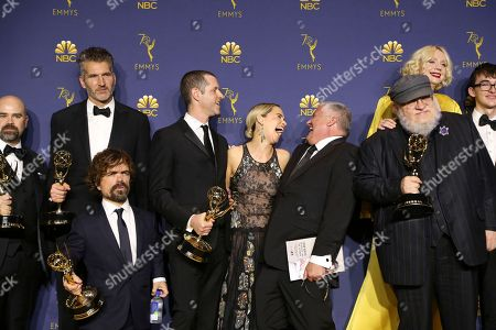 """George R.R. Martin, David Benioff, D.B. Weiss, Emilia Clarke, Peter Dinklage, Gwendoline Christie, Conleth Hill, Isaac Hempstead Wright. George R.R. Martin and the cast and crew of """"Game of Thrones"""" pose in the press room with the award for outstanding drama series for """"Game of Thrones"""" at the 70th Primetime Emmy Awards, at the Microsoft Theater in Los Angeles"""