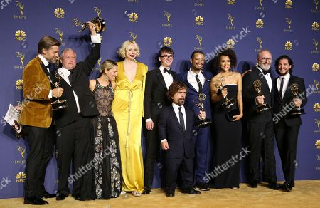 """Nikolaj Coster-Waldau, Peter Dinklage, Conleth Hill, Emilia Clarke, Gwendoline Christie, Isaac Hempstead Wright, Jacob Anderson, Nathalie Emmanuel, Liam Cunningham, Kit Harington. Nikolaj Coster-Waldau, from left, Conleth Hill, Emilia Clarke, Gwendoline Christie, Isaac Hempstead Wright, Peter Dinklage, Jacob Anderson, Nathalie Emmanuel, Liam Cunningham, and Kit Harington pose in the press room with the award for outstanding drama series for """"Game of Thrones"""" at the 70th Primetime Emmy Awards, at the Microsoft Theater in Los Angeles"""