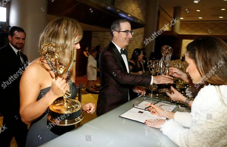 "Liz Stanton, John Oliver. Liz Stanton, left, and John Oliver, winners of the award for outstanding variety talk series for ""Last Week Tonight with John Oliver"" at the 70th Primetime Emmy Awards, at the Microsoft Theater in Los Angeles"