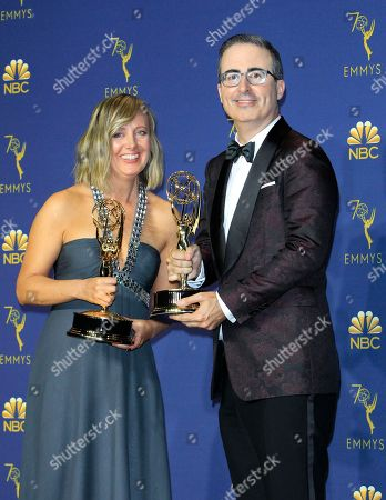 John Oliver (R) and  Liz Stanton (L) hold the Emmy for Outstanding Variety Talk Series for Last Week Tonight with John Oliver at the 70th annual Primetime Emmy Awards ceremony held at the Microsoft Theater in Los Angeles, California, USA, 17 September 2018. The Primetime Emmys celebrate excellence in national prime-time television programming.