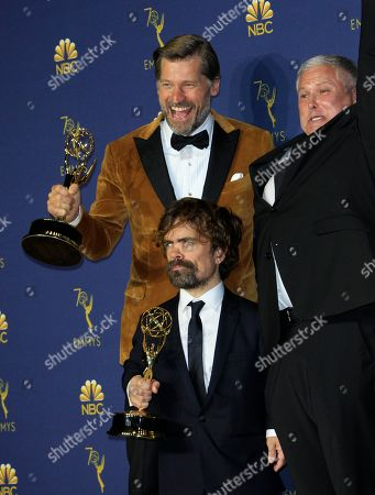 Peter Dinklage (C), Nikolaj Coster-Waldau (L) and Conleth Hill (R) from the Game of Thrones hold the Emmy for Outstanding Drama Series at the 70th annual Primetime Emmy Awards ceremony held at the Microsoft Theater in Los Angeles, California, USA, 17 September 2018. The Primetime Emmys celebrate excellence in national prime-time television programming. Dinklage also won Supporting actor in a drama series.
