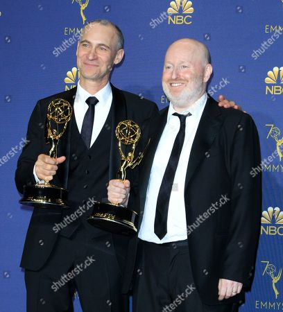 Joel Fields (L) and Joe Weisberg (R) hold the Emmy for Outstanding Writing for a Drama Series for The Americans at the 70th annual Primetime Emmy Awards ceremony held at the Microsoft Theater in Los Angeles, California, USA, 17 September 2018. The Primetime Emmys celebrate excellence in national prime-time television programming.