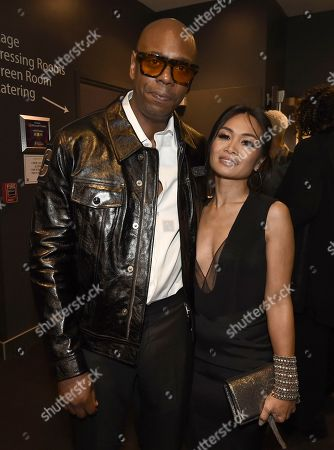 Dave Chappelle, Elaine Chappelle. Dave Chappelle, left, and Elaine Chappelle appear backstage at the 70th Primetime Emmy Awards, at the Microsoft Theater in Los Angeles