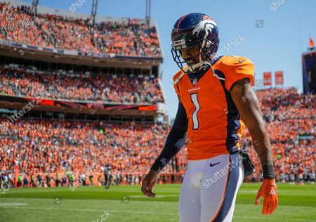 Denver Broncos punter Marquette King (1) paces the sidelines during the first half of an NFL football game against the Seattle Seahawks, in Denver