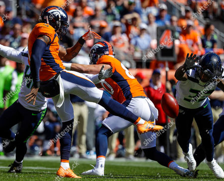 Denver Broncos punter Marquette King (1) punts against the Seattle Seahawks during the first half of an NFL football game, in Denver
