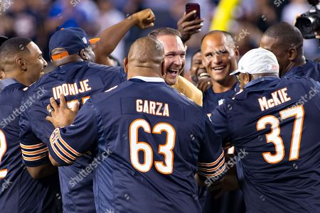 Chicago, Illinois, U.S. - Former Bear Linebacker Brian Urlacher jokes with his old teammates at the celebration of his Hall of Fame Induction during halftime at the NFL Game between the Seattle Seahawks and Chicago Bears at Soldier Field in Chicago, IL. Photographer: Mike Wulf