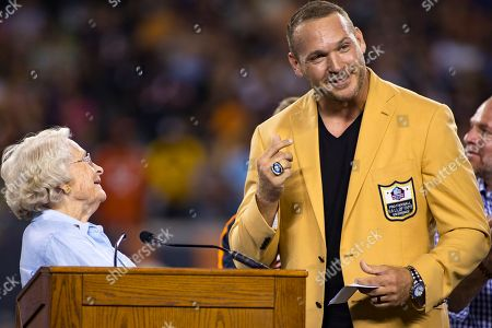 Stock Photo of Chicago, Illinois, U.S. - Former Bear Linebacker Brian Urlacher speaks at the celebration of his Hall of Fame Induction with Virginia McCaskey during halftime at the NFL Game between the Seattle Seahawks and Chicago Bears at Soldier Field in Chicago, IL. Photographer: Mike Wulf