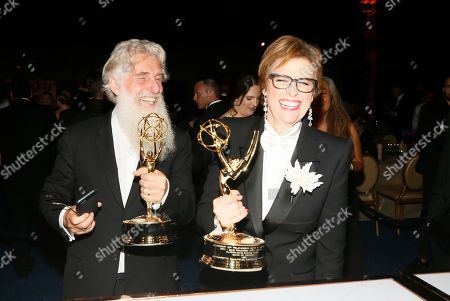 """Chris Newman, Bernadette Caulfield. Chris Newman, left, and Bernadette Caulfield, winners of the award for outstanding drama series for """"Game of Thrones"""", at the Governors Ball Winners Circle at the 70th Primetime Emmy Awards, at the Microsoft Theater in Los Angeles"""