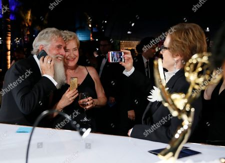 """Chris Newman, Bernadette Caulfield. Chris Newman, far left, and Bernadette Caulfield, winners of the award for outstanding drama series for """"Game of Thrones"""", at the Governors Ball Winners Circle at the 70th Primetime Emmy Awards, at the Microsoft Theater in Los Angeles"""