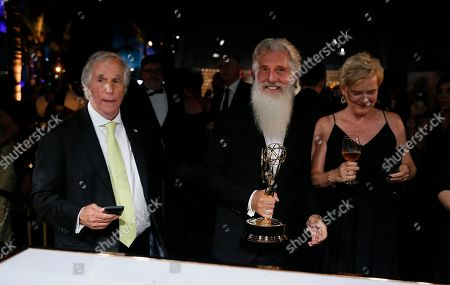 """Henry Wrinkler, Chris Newman. Henry Wrinkler, left, and Chris Newman, winner of the award for outstanding drama series for """"Game of Thrones"""" at the Governors Ball Winners Circle at the 70th Primetime Emmy Awards, at the Microsoft Theater in Los Angeles"""