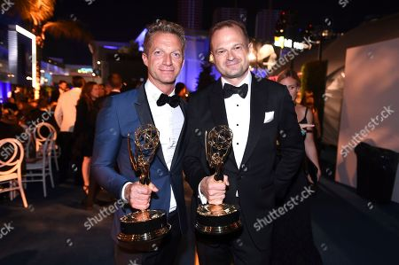 Stock Picture of Tom Rob Smith, Bradford Simpson. Tom Rob Smith, left, and Bradford Simpson attend the Governors Ball for the 70th Primetime Emmy Awards, at the Microsoft Theater in Los Angeles