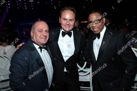 Matteo Lunelli, Hayma Washington. Ferrari president and owner Matteo Lunelli, center, Hayma Washington, Chairman and CEO of the Television Academy, right, and guest attend the Governors Ball for the 70th Primetime Emmy Awards, at the Microsoft Theater in Los Angeles