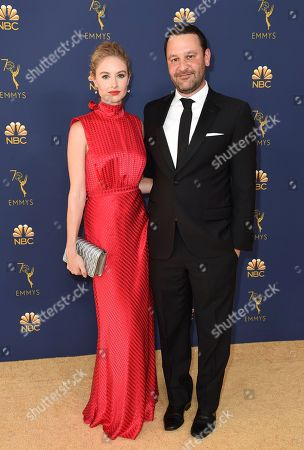 Dan Fogelman, Caitlin Thompson. Dan Fogelman, right, and Caitlin Thompson arrive at the 70th Primetime Emmy Awards, at the Microsoft Theater in Los Angeles