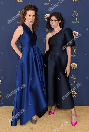 Liz Flahive, Carly Mensch. Liz Flahive, left, and Carly Mensch arrive at the 70th Primetime Emmy Awards, at the Microsoft Theater in Los Angeles