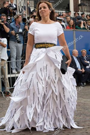 """Marianne Thieme of the Animal Right's Party wears a dress with a ribbon reading """"Power Plant"""" adorned with lapels listing various vegetarian dishes as she arrives at the Knight's Hall in The Hague, Netherlands, for a ceremony marking the opening of the parliamentary year with a speech by King Willem-Alexander outlining the government's budget plans for the year ahead"""