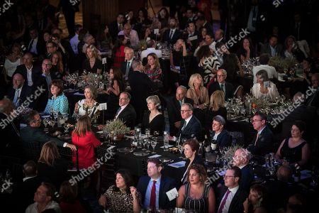 Prime Minister Theresa May sits at the Top Table with Sir Mick Davis, Chief Rabbi Ephraim Mirvis, Gerald Ronson, Rabbi Laura Janner Klausner, Ambassador Mark Regev.